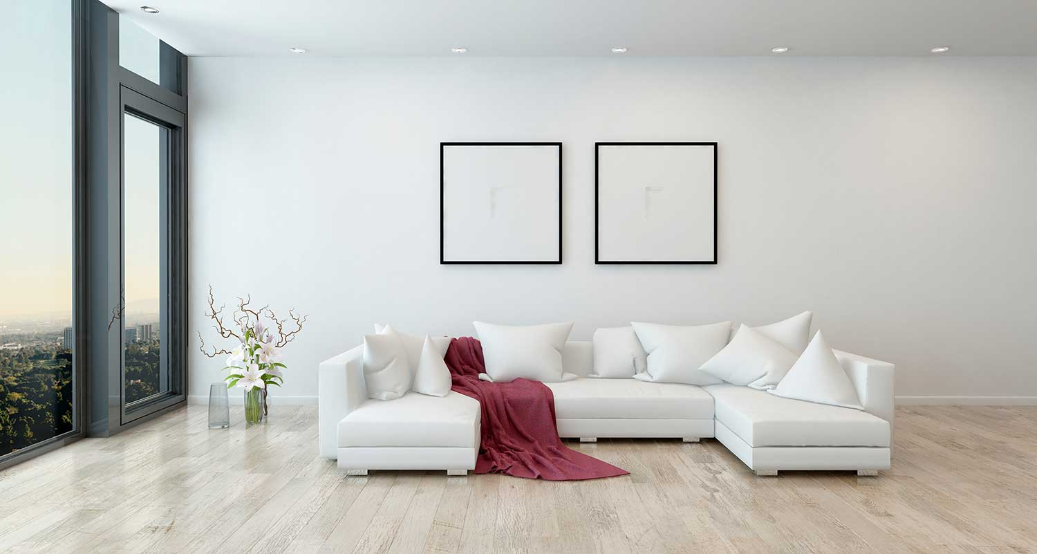 An Engineered Hardwood floor installed in a luxurious living room with a white sofa.