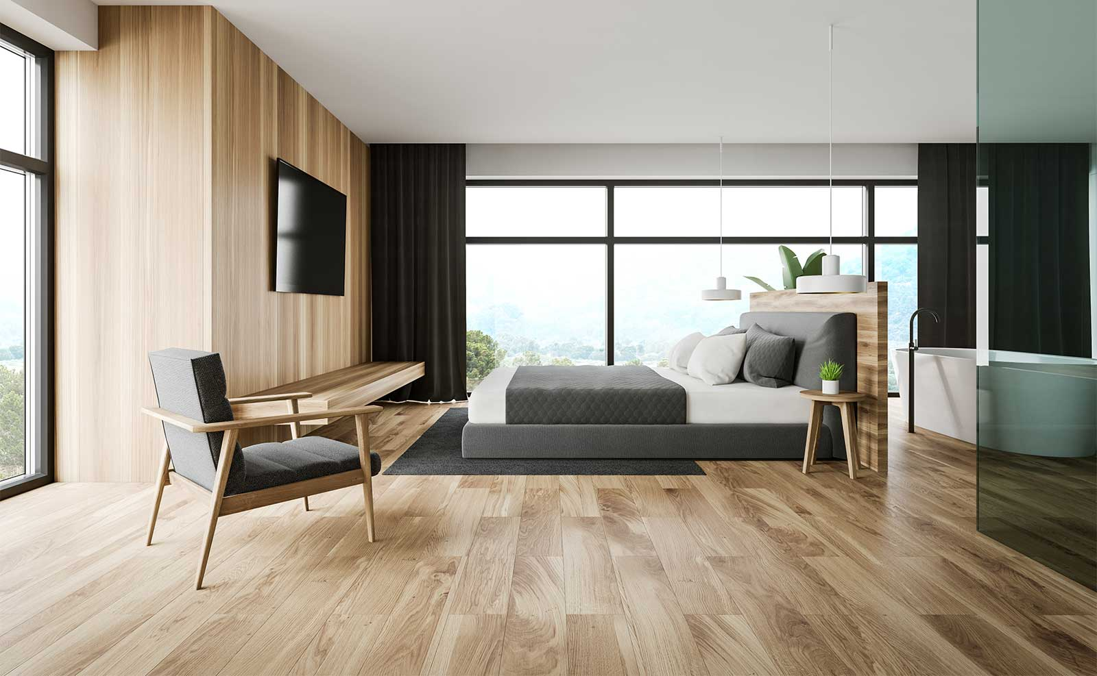 Golden-colored laminate floors in a modern master bedroom and bathroom.