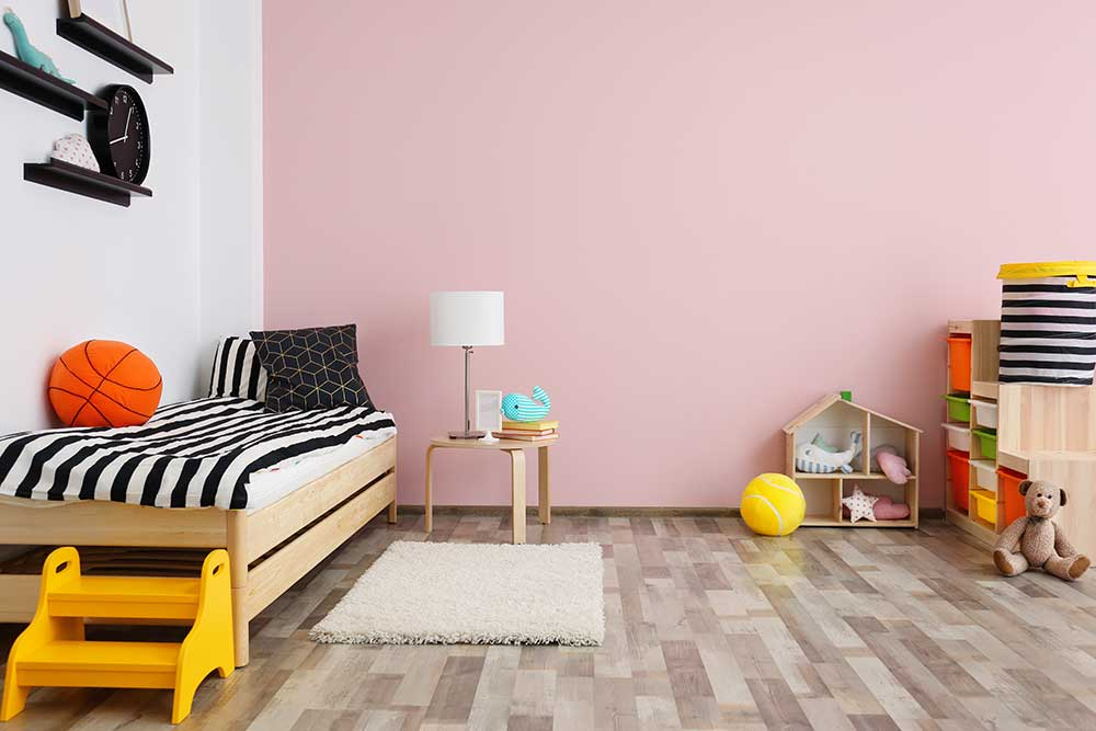 A kid's room with multi-colored vinyl floors.